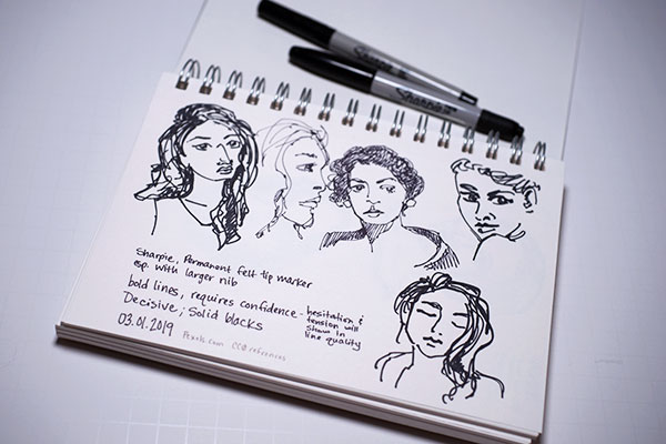 Sharpie marker sketch of several female portraits
