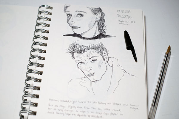 Sketch of a female portrait and a male portrait in ballpoint pen
