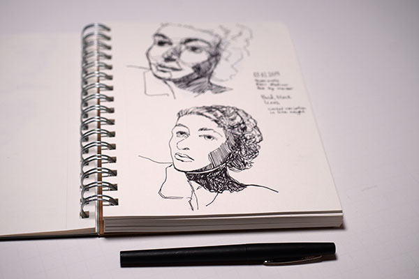 Felt tip marker sketch of two female portraits