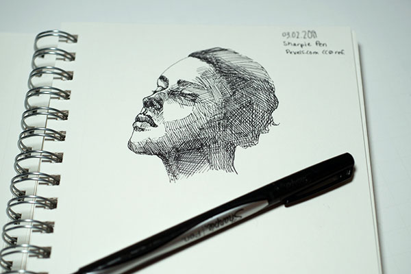 Sharpie pen sketch of a woman's face in profile