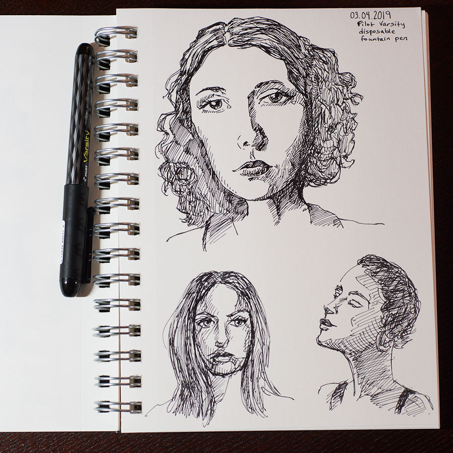 Sketch of three faces made with a black fountain pen