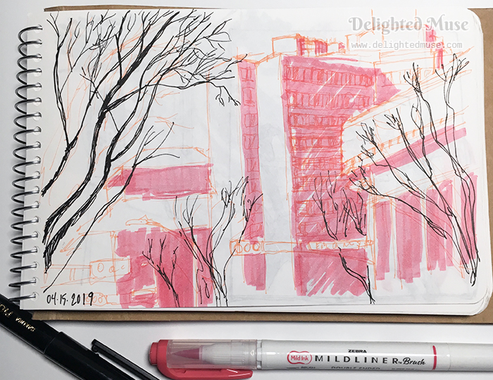 Sketchbook page showing buildings in pink highlighter and trees in black ink