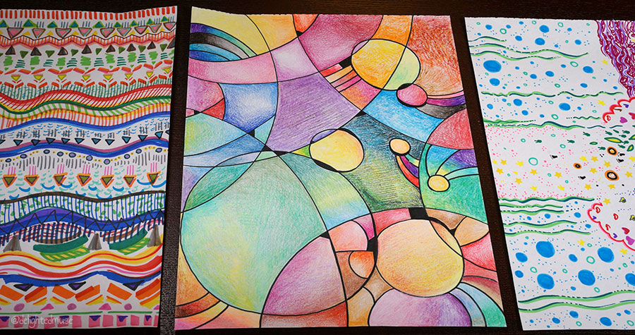 Three abstract drawings made with crayons and markers