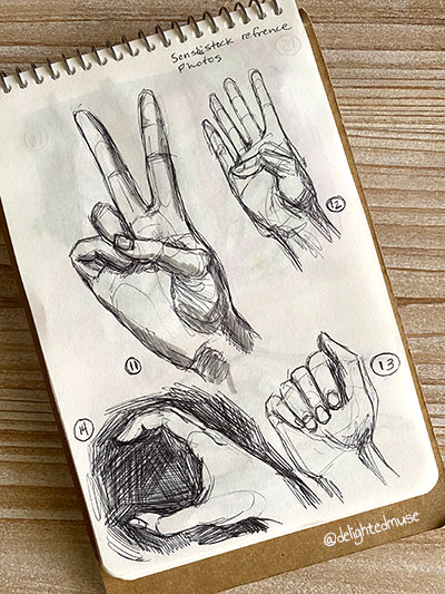 Black ballpoint pen drawings of four hands