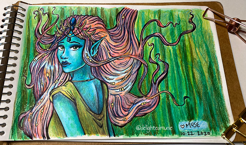Sketchbook page of a blue-skinned mermaid with pink flowing hair and a seashell crown