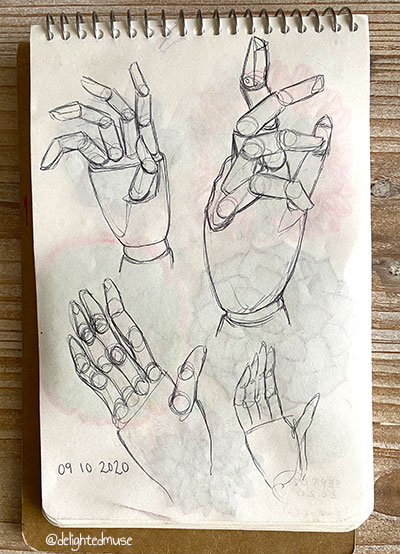 Sketchbook page of a wood mannequin hand, drawn in ballpoint pen