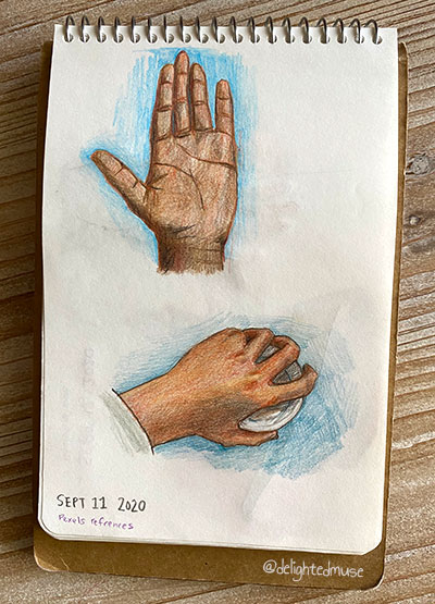 A sketchbook page showing to hand studies with darker skin tones, one open and showing the palm and one holding the top of a coffee cup and showing the back of the hand