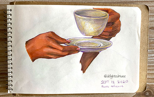 Hand studie of two darker skined handes holding a cream-colored, porcelain tea cup and saucer set.