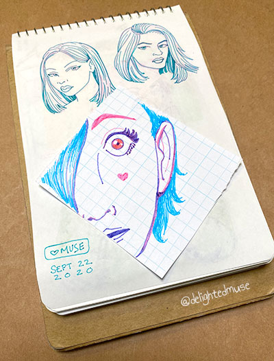Sketchbook page of three faces drawn in blue and pink pen. Two of the top faces look annoyed, the bottom one looks surprised