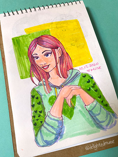 A sketchbook drawing of a stylized cartoon girl in a hoodie.