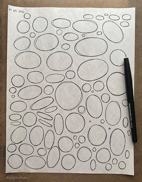 A newsprint sheet of ellipses drawn in felt pen