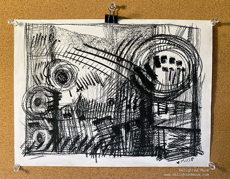 Charcoal drawing of abstract lines and shapes on white paper, with the drawing pinned to a bulletin board.