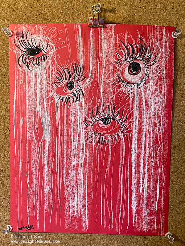 Red paper with vertical white charcoal marks and black charcoal shapes like eyes with long eyelashes