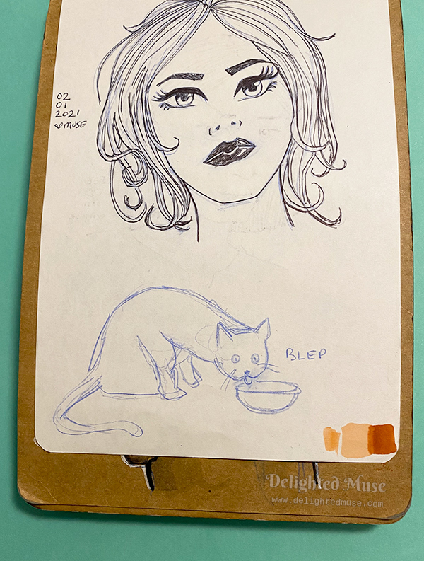 Sketchbook page with a doodle of a cat sticking out its tongue and the word blep