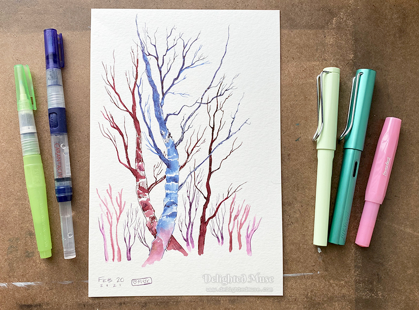 Drawing of bare tree branches, with three fountain pens and two water brushes on the side of the paper