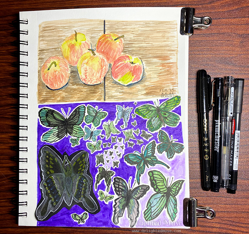 Sketchbook page with a watercolor painting of five apples on a wooden table. The second half the page contains painted butterflies in green and black.