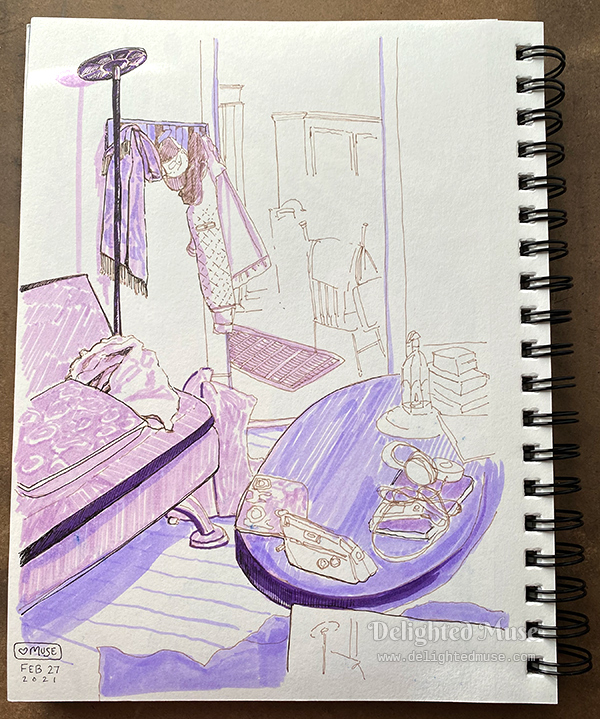 Sketchbook page with a linear drawing of a living room, showing a futon, lap, wall coat rack, and coffee table.