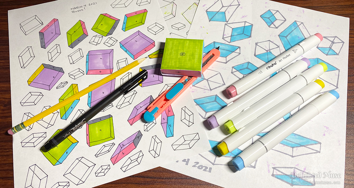 Three sheets of drawings of boxes. Ontop rest a pencil, pen, markers, a craft knife, and a three dimensional paper box.