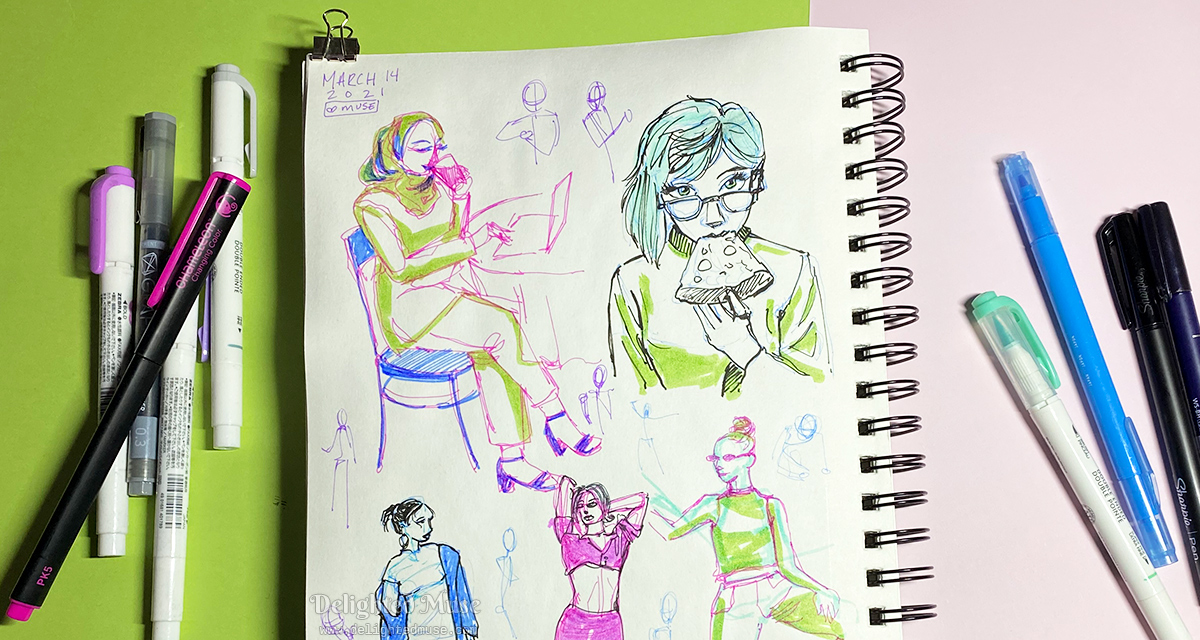 A sketchbook page with figure sketches, including a girl eating a slice of pizza. Piles of pens are laid next to the sketchbook on both sides.