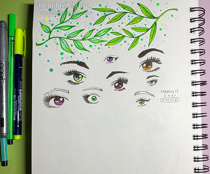 Sketchbook page with drawings of bright green branches of leaves and stylized eyes.